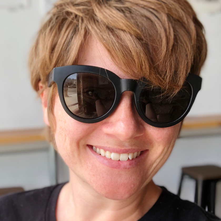 person with sunglasses smiling