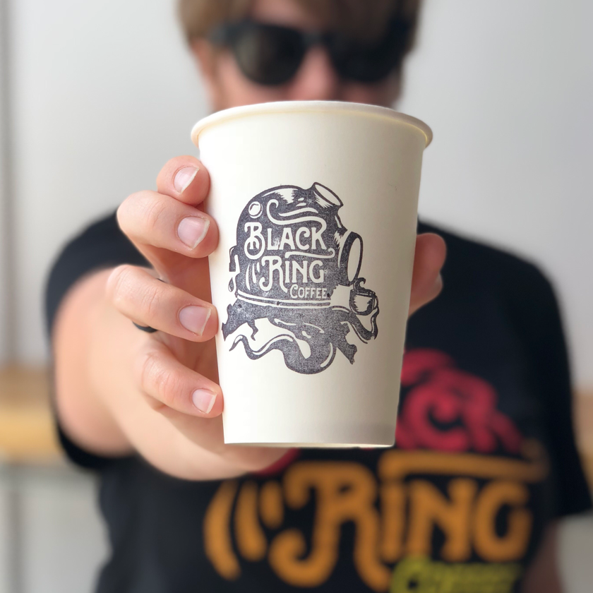 coffee cup with black logo design