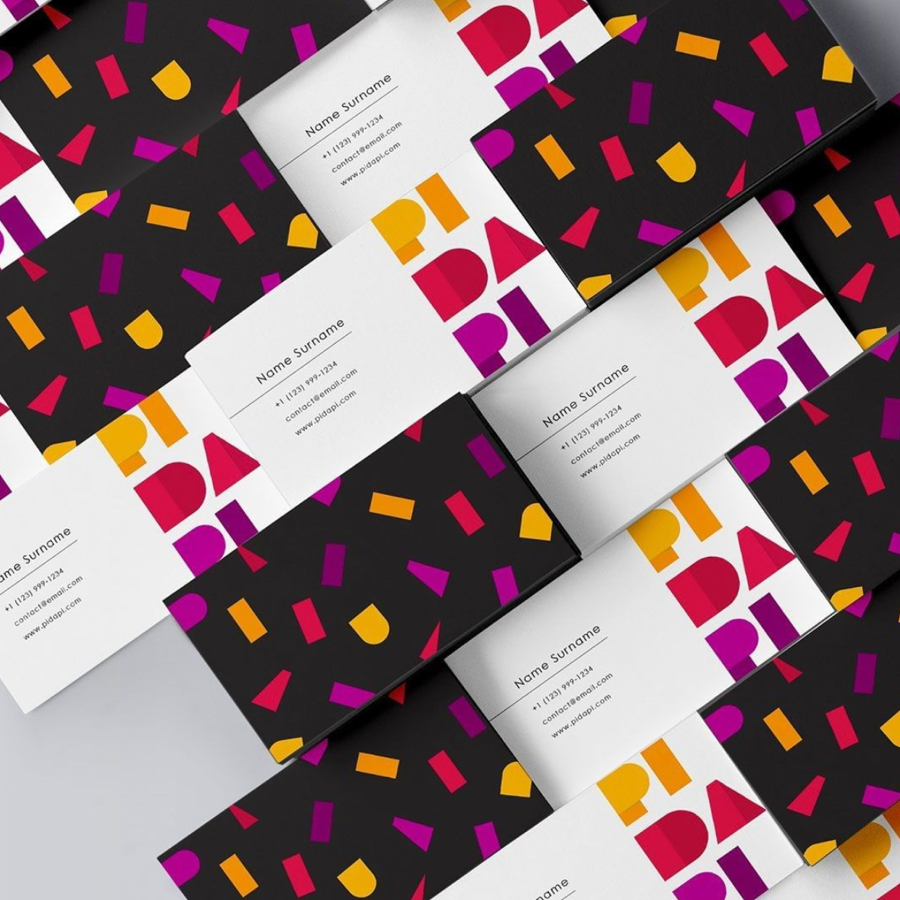 business cards with purple, black and orange design