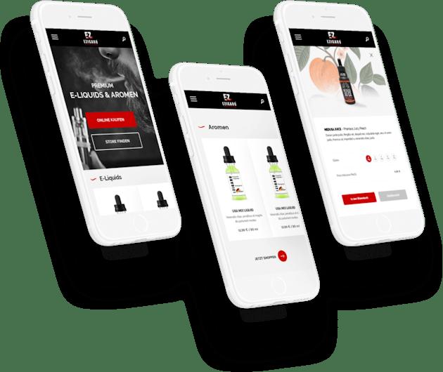 赤と黒色のウェブデザインが表示されている3台のスマホ
