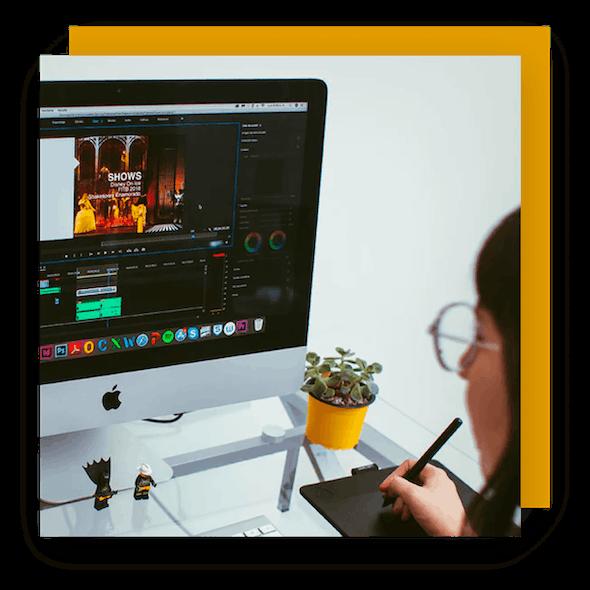 filmmaker editing video on an imac using a wacom tablet